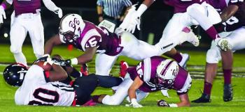 Five Breaux Bridge defenders converge on a Northside ball carrier during last Friday's 5-4A battle. The group includes Joseph Williams (2), Orel Ledet (15), Quinton Thibodeaux (36), Lamontre Huval (5) and Isayah Wiltz (38). The Tiger defense delivered 5 turnovers and a blocked punt in a 33-0 shutout victory.