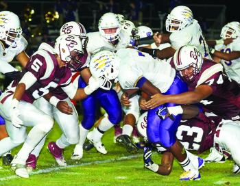 WESTGATE QB James Walker is surrounded by Breaux Bridge defenders, including Keithan Cormier (74), Corey Louis (23) and Lamontre Huval (5). The stingy Tigers limited Westgate to 73 net yards rushing in a 28-15 victory.