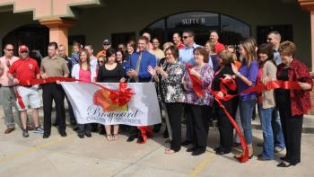 Dr. Lon Latiolais, DDS, cuts the ribbon on his new dental clinic in Broussard.