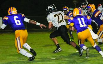 Kaplan running back Grant Frick (27) races past St. Martinville defenders Trey Wiltz (6), Draper Anthony (11) and Brodie Fredieu (18) on his way to a 21-yard touchdown last Friday. The Class 3A Pirates rained on SM's homecoming festivities, handing the Tigers a 42-13 thumping.