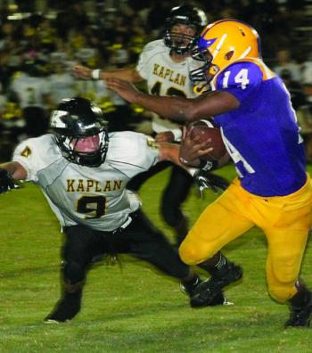 MALIK ANTHONY (14) of St. Martinville cuts away from a Kaplan defender last Friday. The senior running back finished with 65 yards and a TD on 15 carries.