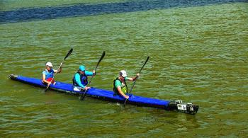 Honed by the 260-mile Texas Water Safari, Virginia Parker of Austin and Sandy Yonley  and Morgan Kohut of Houston paddle to a TDT Racing Division victory at Berwick's Lighthouse Park.