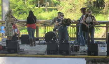 BON SOIR CATIN, with Christine Balfa (right), entertains on the stage at Parc des Ponts de Pont Breaux during the first Shake Your Trail Feather free music concert last  year. Money raised through sales of a $5 festival pin and concessions to  toward the establishment of a Bayou Teche Paddle Trail.